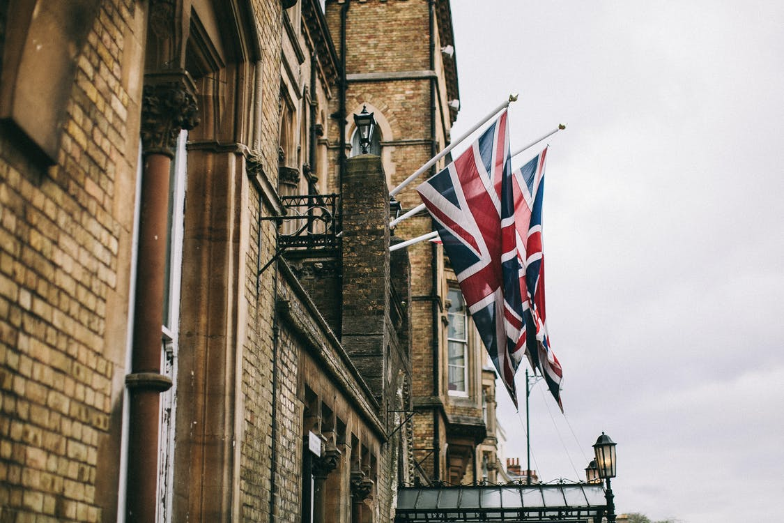 Hanged Flags Beside Building