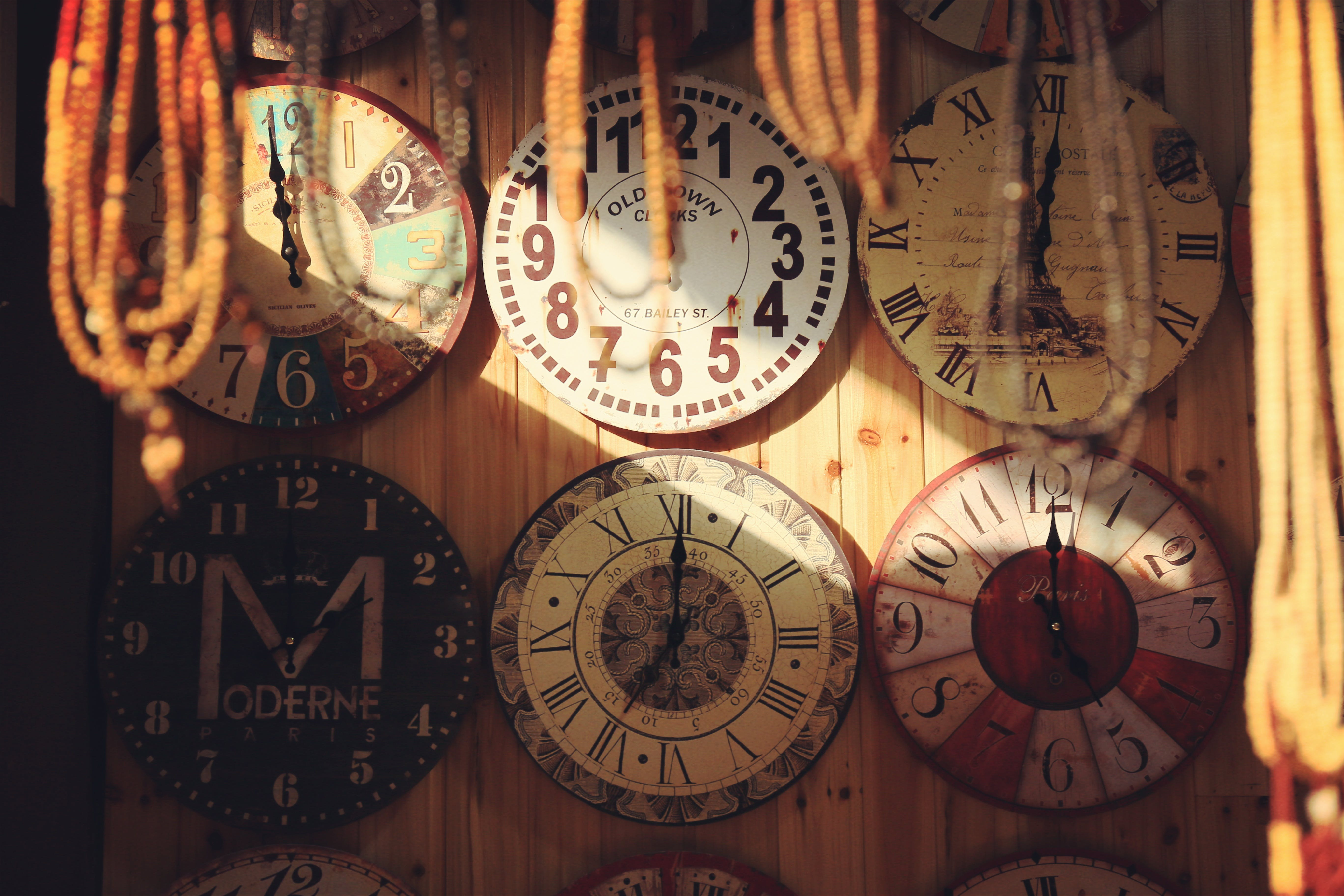 Beige and White Clocks on Wall