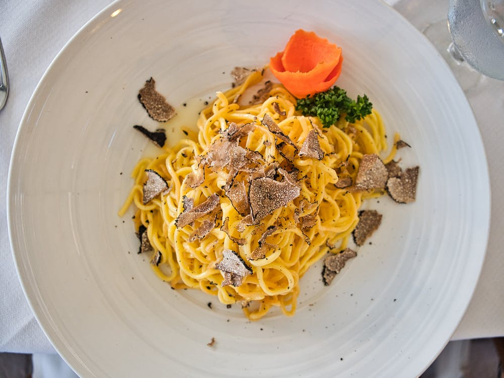Tagliatelle Funghi Porcini e Tartufo (Pasta Noodle with Porcini and Truffle Mushrooms) - traditional dish in florence