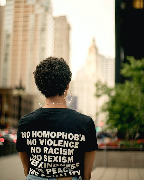 Woman in Black Shirt With Text Print