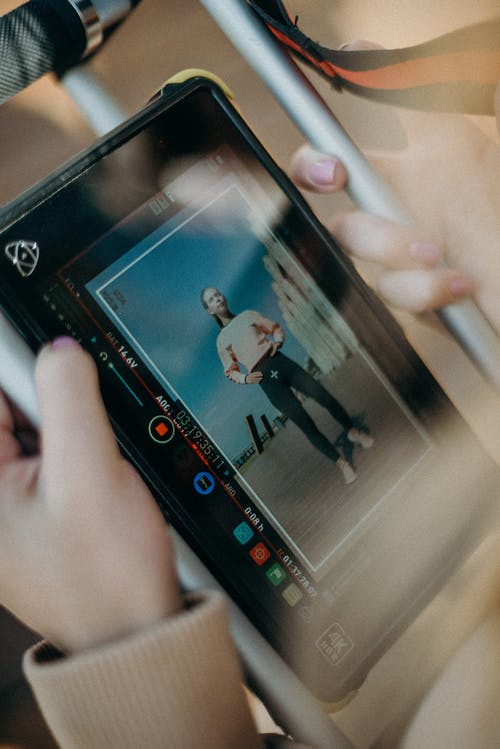 Black Tablet Computer Displaying Woman