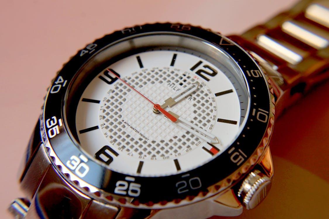 Round Black Tommy Hilfiger Analog Watch Displaying 12:14 Time
