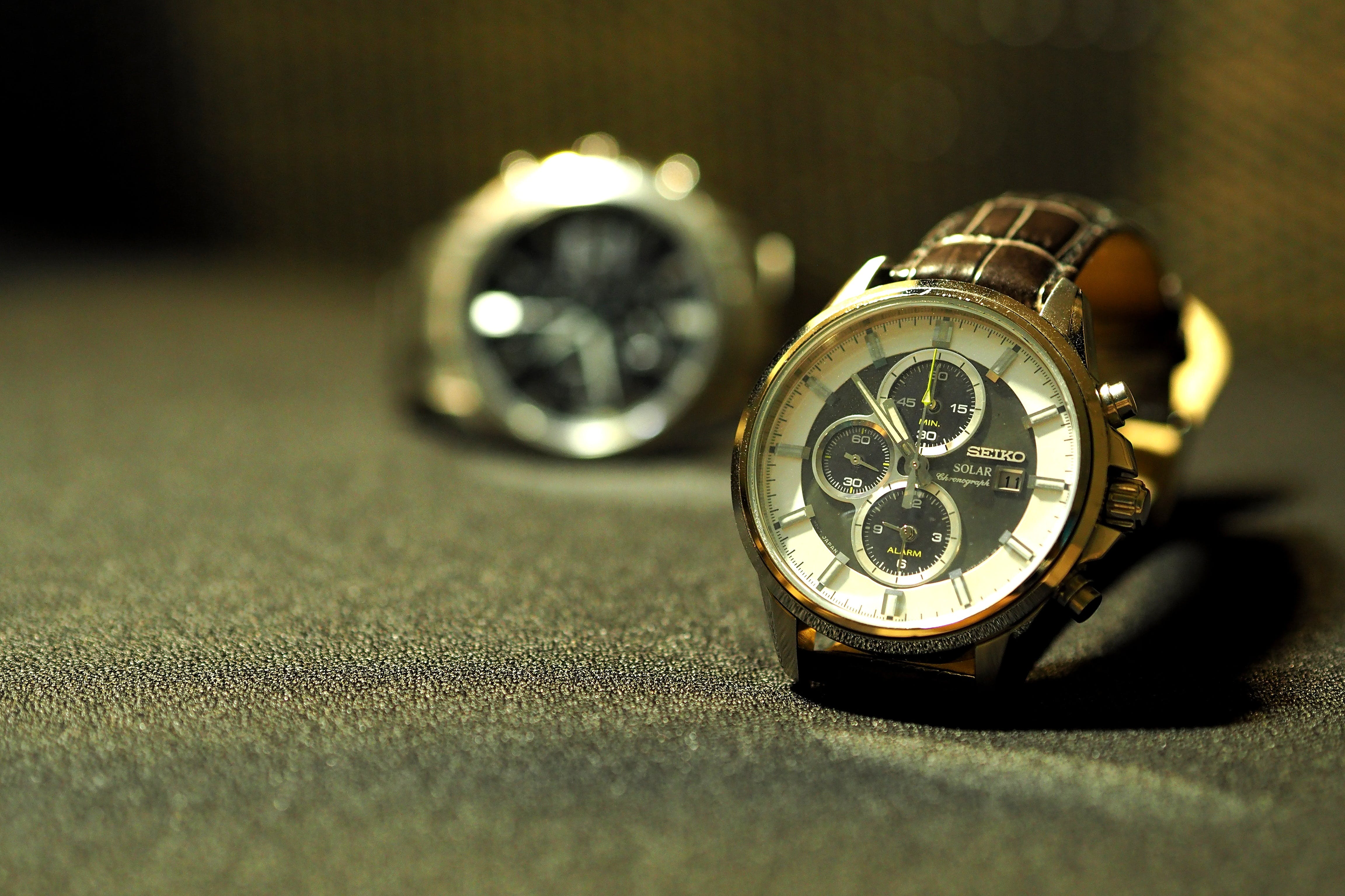 Selective Focus Photography of Round Silver-colored Chronograph Watch With Link Bracelet