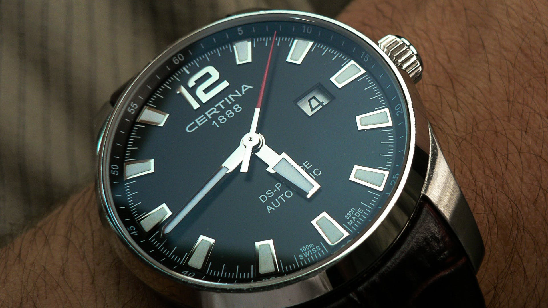 Person Wearing Round Silver-colored Certina Watch Displaying 5:44