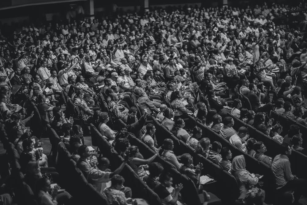 People sitting inside the movie theater. | Photo: Pexels