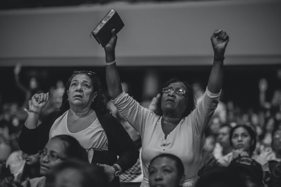Grayscale Photography of People Worshiping