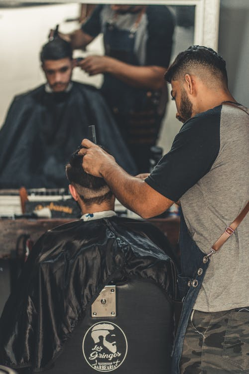 Photo of Man Having a Haircut