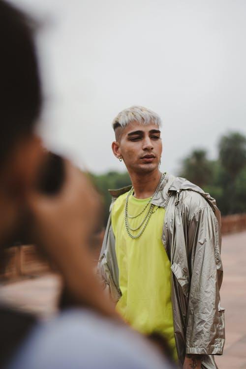 Photo of Man Wearing Silver Jacket