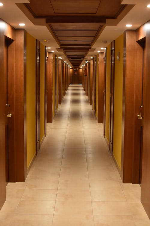Turned-on Lights Along Hotel Hallway
