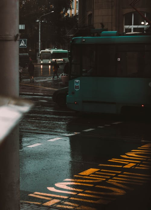 Grey Tram on Wet Street