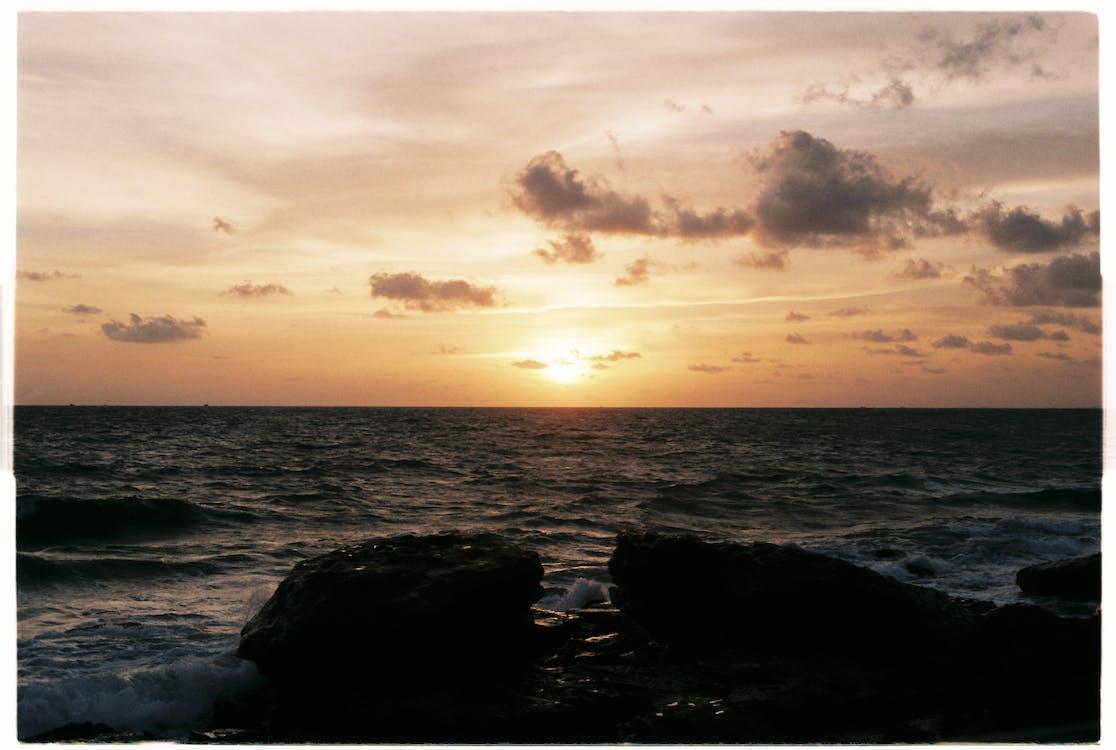 Photo Of Ocean During Dawn