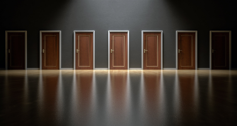 Closed Brown Wooden Doors Inside Poor Lighted Room