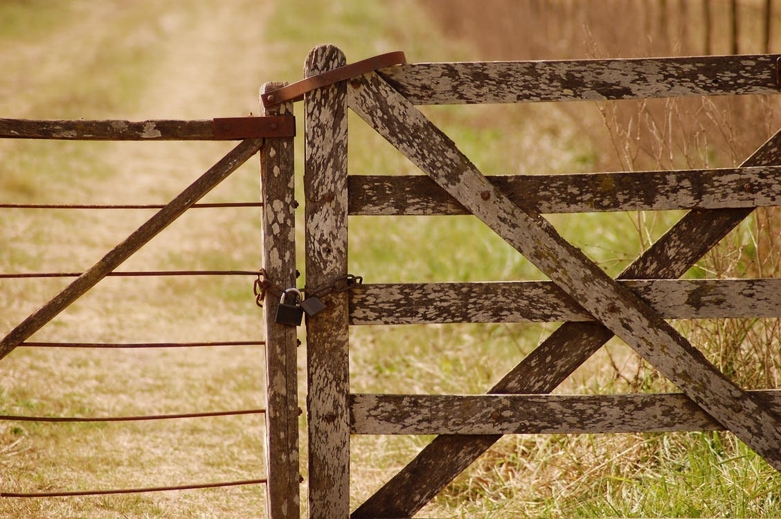 Locked White and Brown Wooden Gate