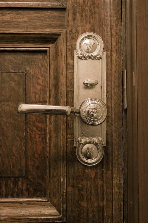 Brown Door With Silver Door Lever