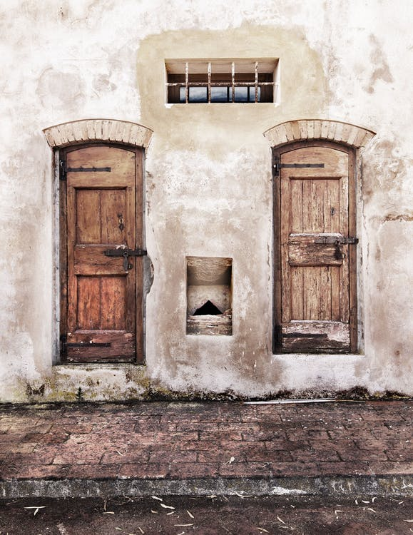 Minimalist Photography of Two Closed Wooden Doors