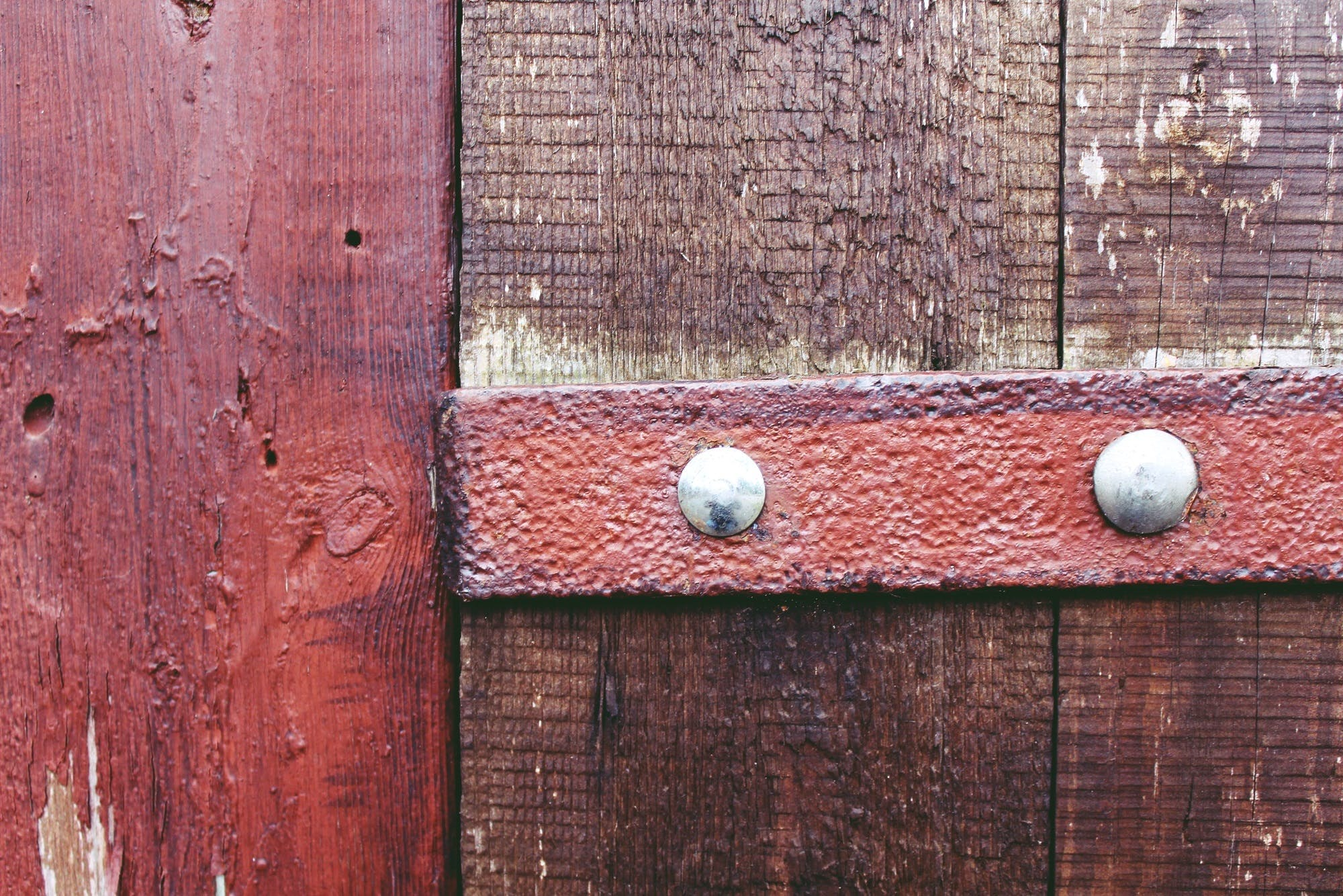 Two Gray Nails on Brown Wooden Fence