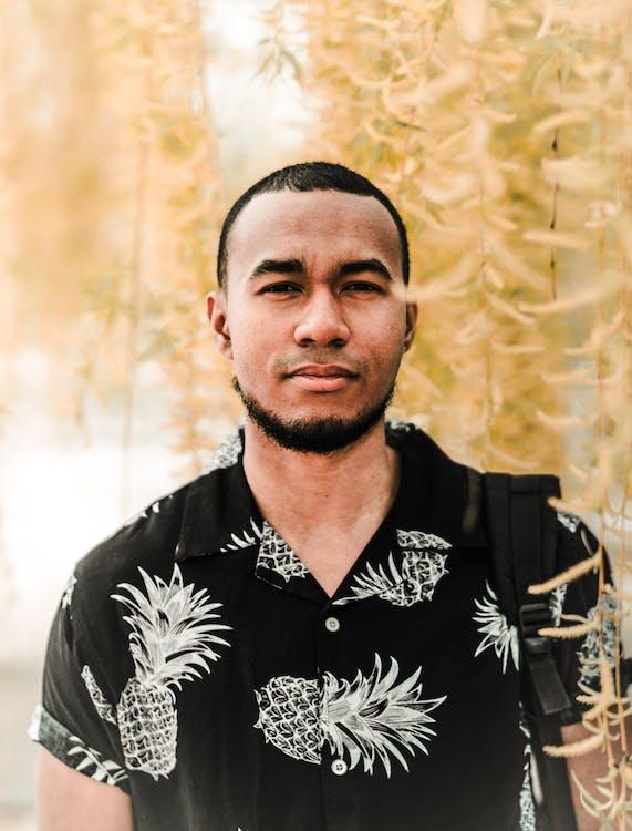 Photo of Man Wearing Black Top