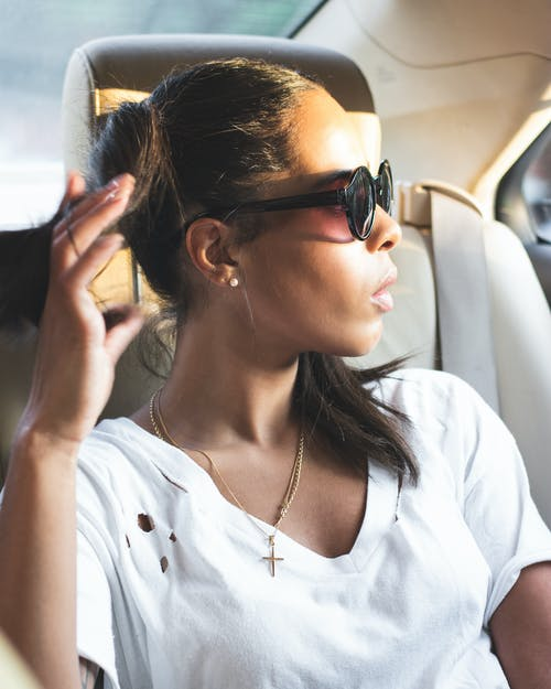 Photo of Woman Wearing Sunglasses