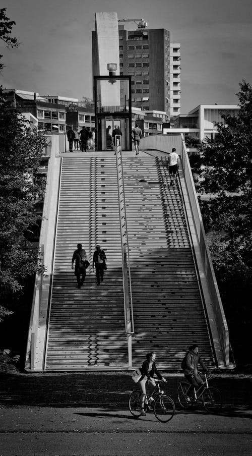 Grayscale Photography of People Walking on Stairs