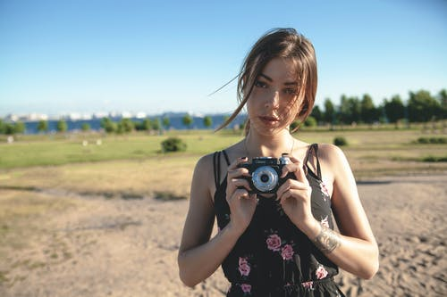 Photo of Woman Holding a Camera