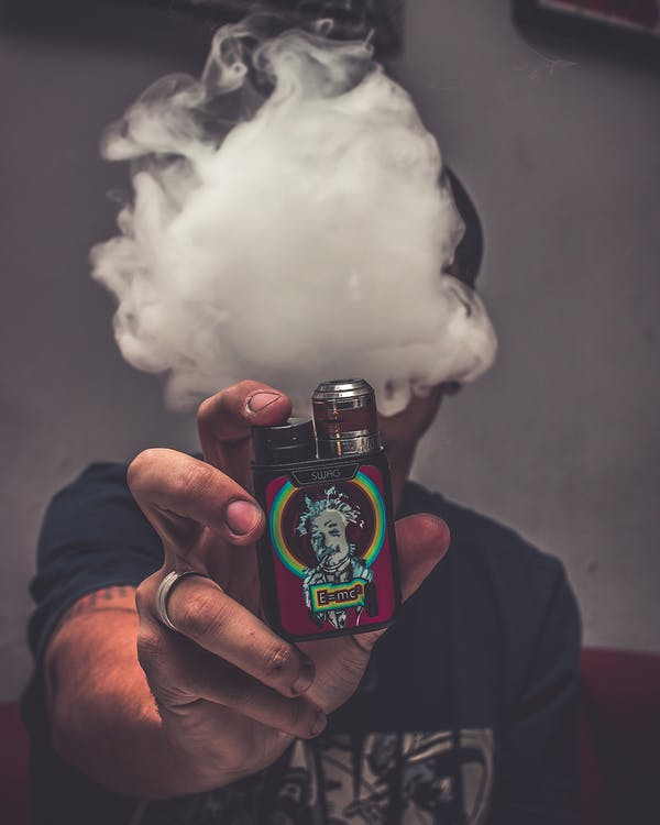 Photo Of Person Holding Vape