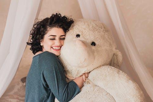 Smiling Woman Hugging Life Size Plush Toy