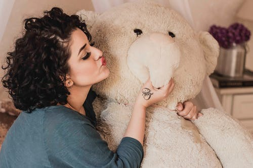 Woman Giving A Kiss To Life Sized Plush Toy