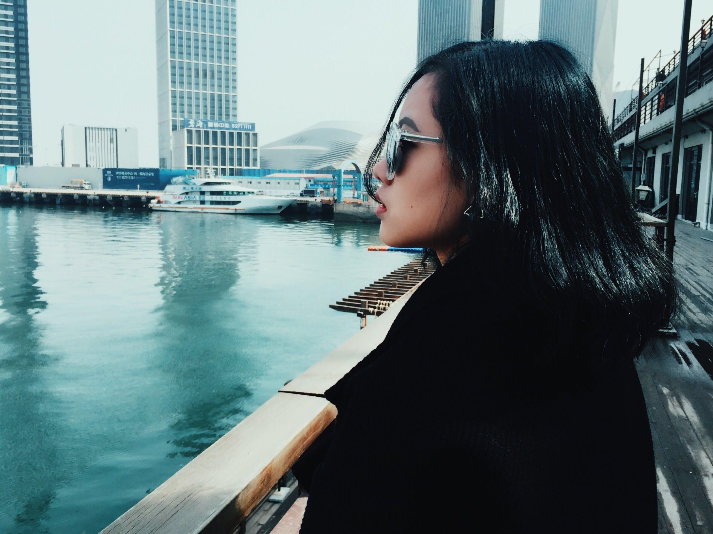 Woman Wearing Sunglasses Looking Towards Body of Water