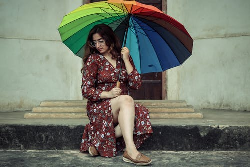 Photo Of Woman Holding Colorful Umbrella