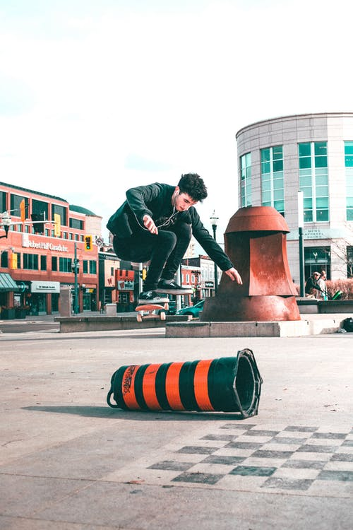 Photography of Man Playing Skateboard Doing Tricks