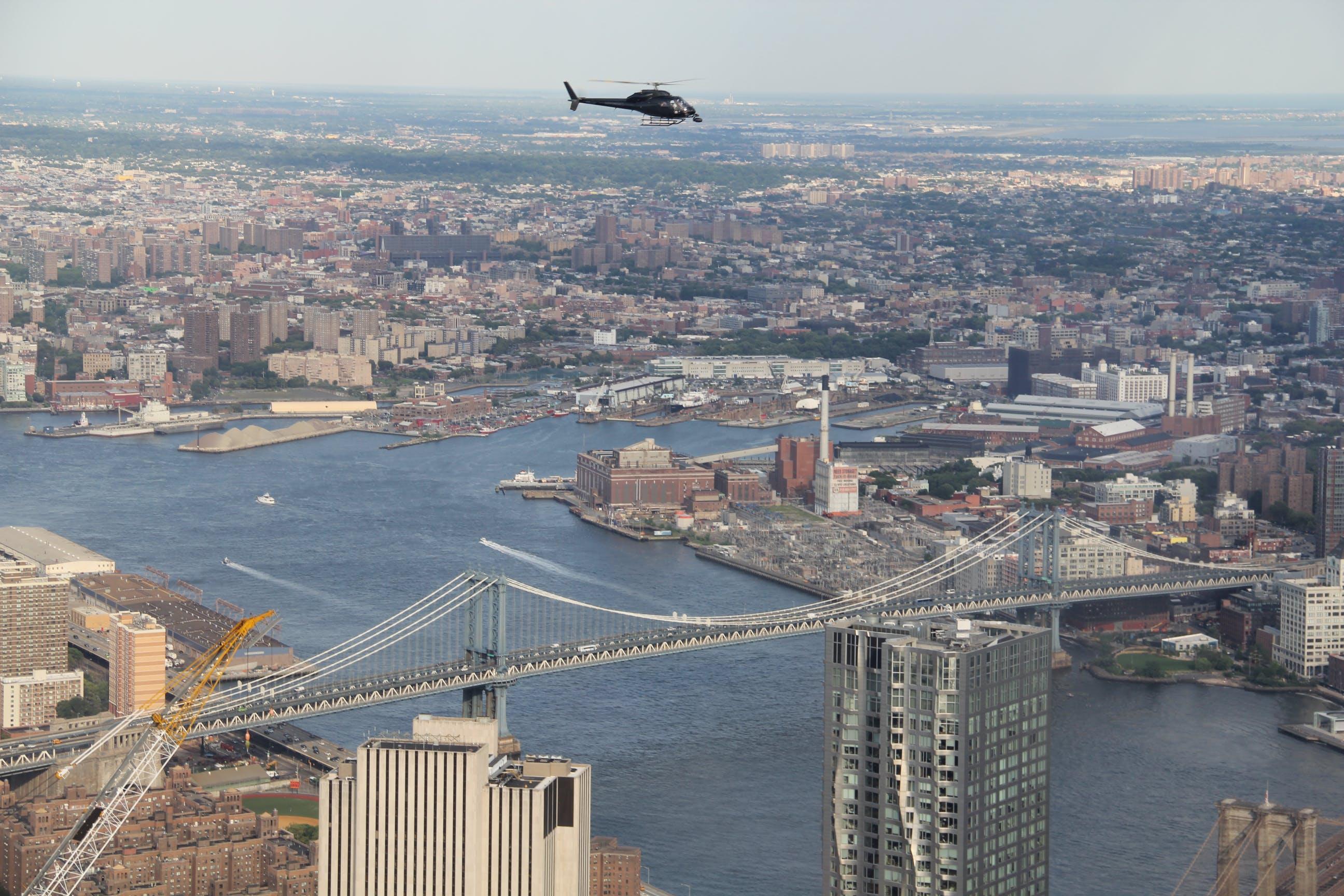 Free stock photo of bridge, chopper, chopper over the city, new york city