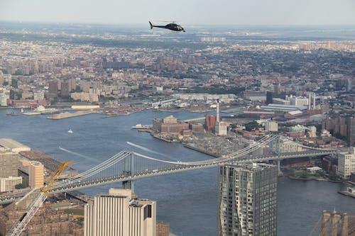 Free stock photo of bridge, chopper, chopper over the city