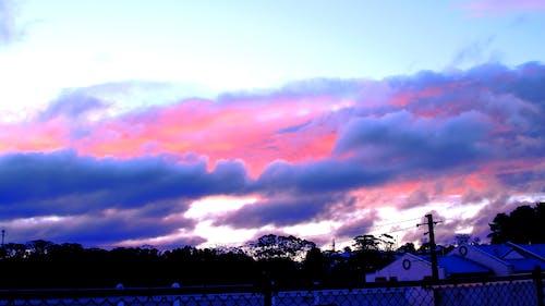 Immagine gratuita di colline, nuvole, tempesta, tramonto