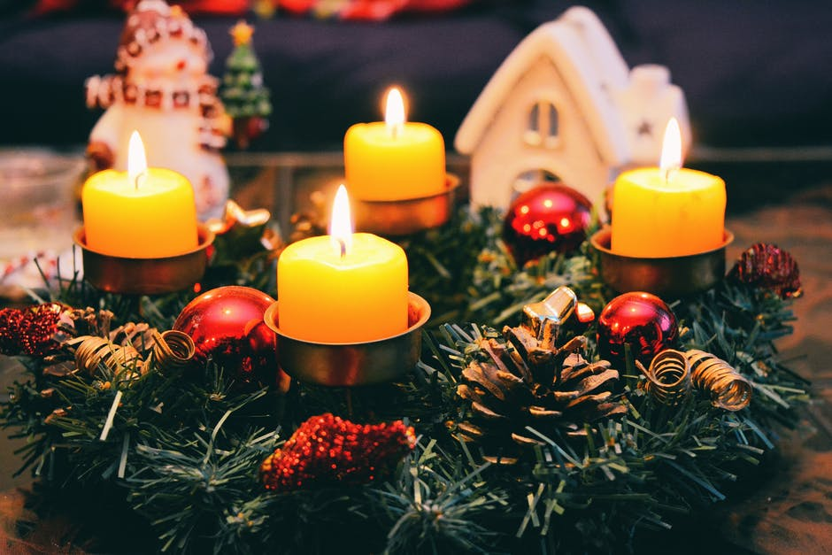Four Yellow Lighted Candles