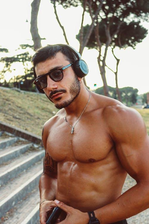 Δωρεάν στοκ φωτογραφιών με bodybuilder, bodybuilding, bokeh, gadget