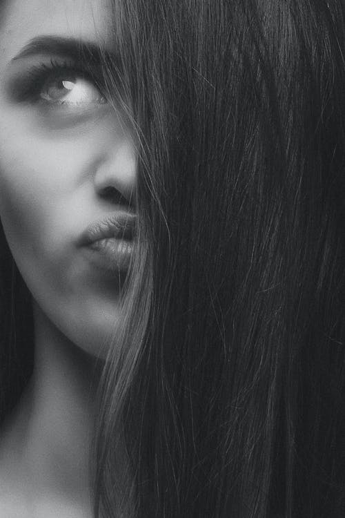 Monochrome Photo Of Woman Pouting Lips