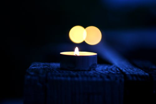 Bokeh Photography of Lighted Tealight Candle