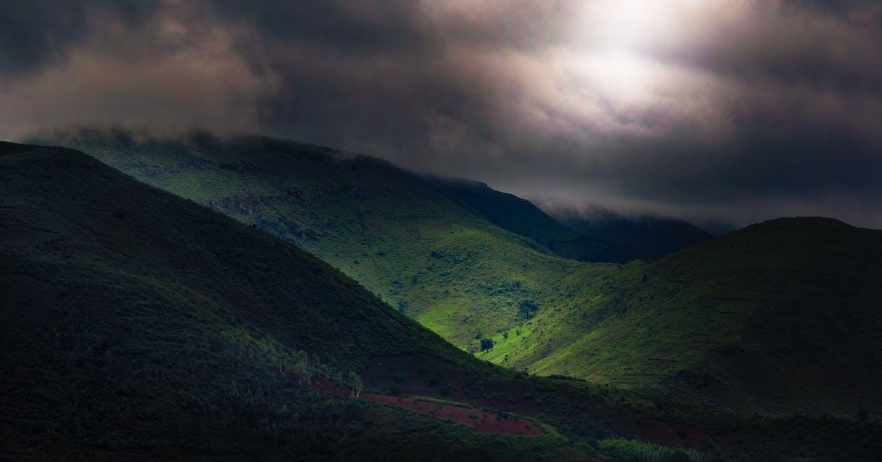 Green Mountains Under Dark Sky