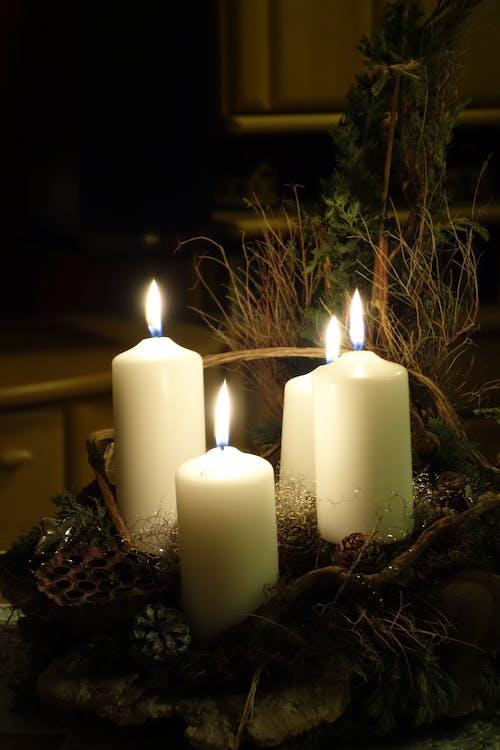 Four Pillar Candles on Table