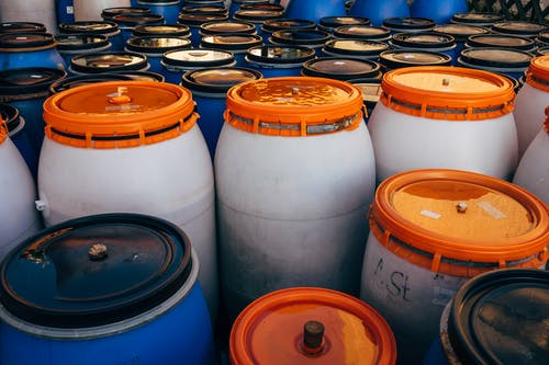 White and Orange Plastic Barrels