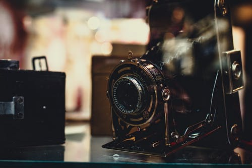 Black and Gray Camera on Glass-top Surface