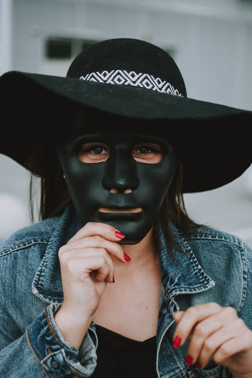 Person Wearing Black Mask