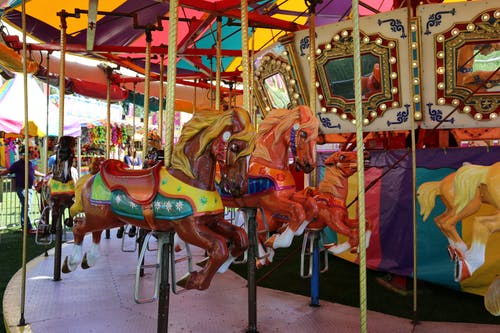 Photos gratuites de attractions, carrousel, foire du comté