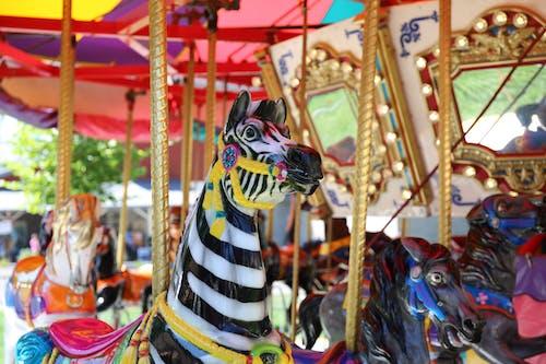 Photos gratuites de attractions, carrousel, par d'attractions
