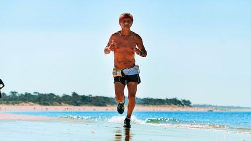 Photo Of Man Running On The Beach
