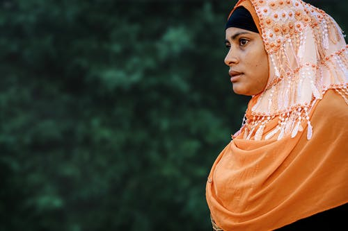 Woman in Orange Hijab on Selective Focus Photography