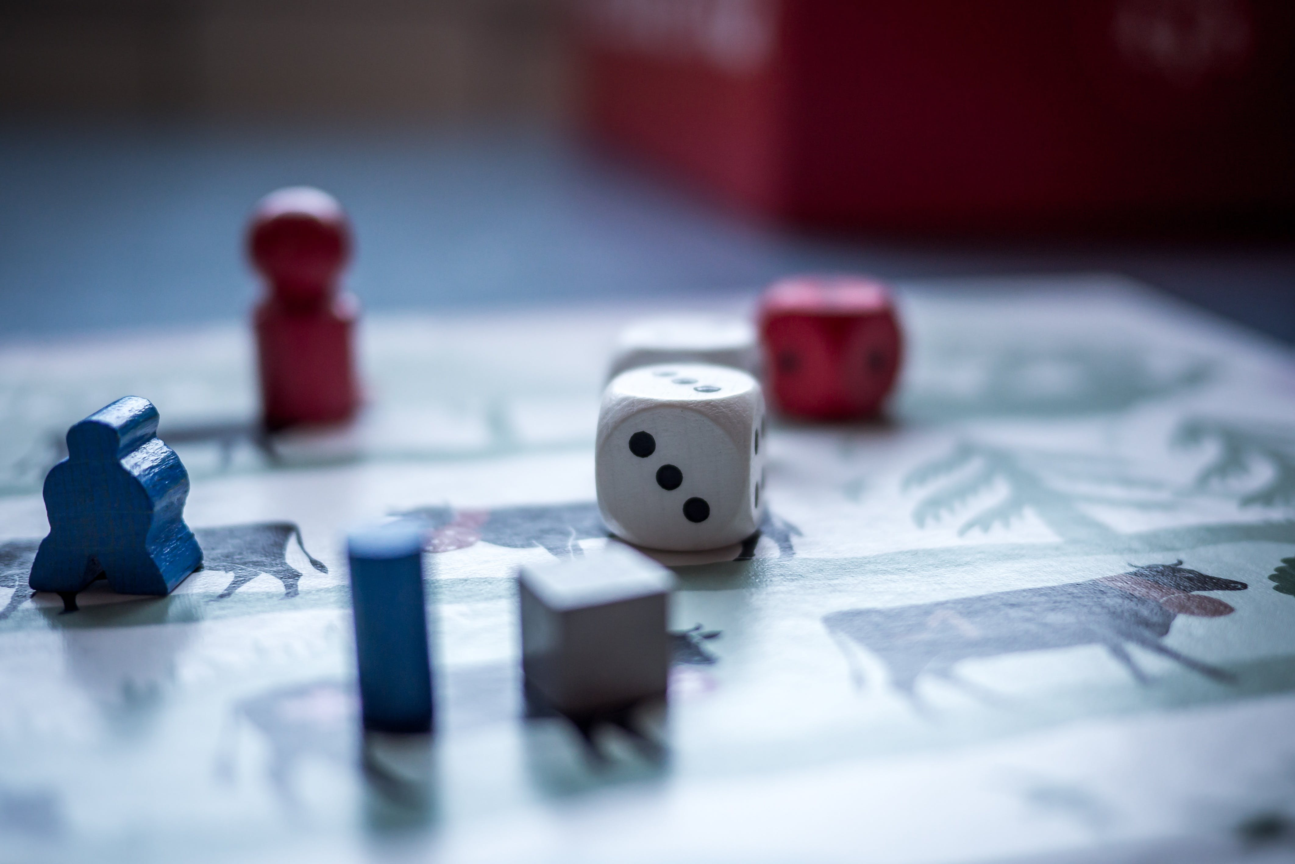 Dices and Wooden Pieces on Game Board