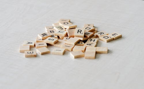 Pile of Scrabble Pieces
