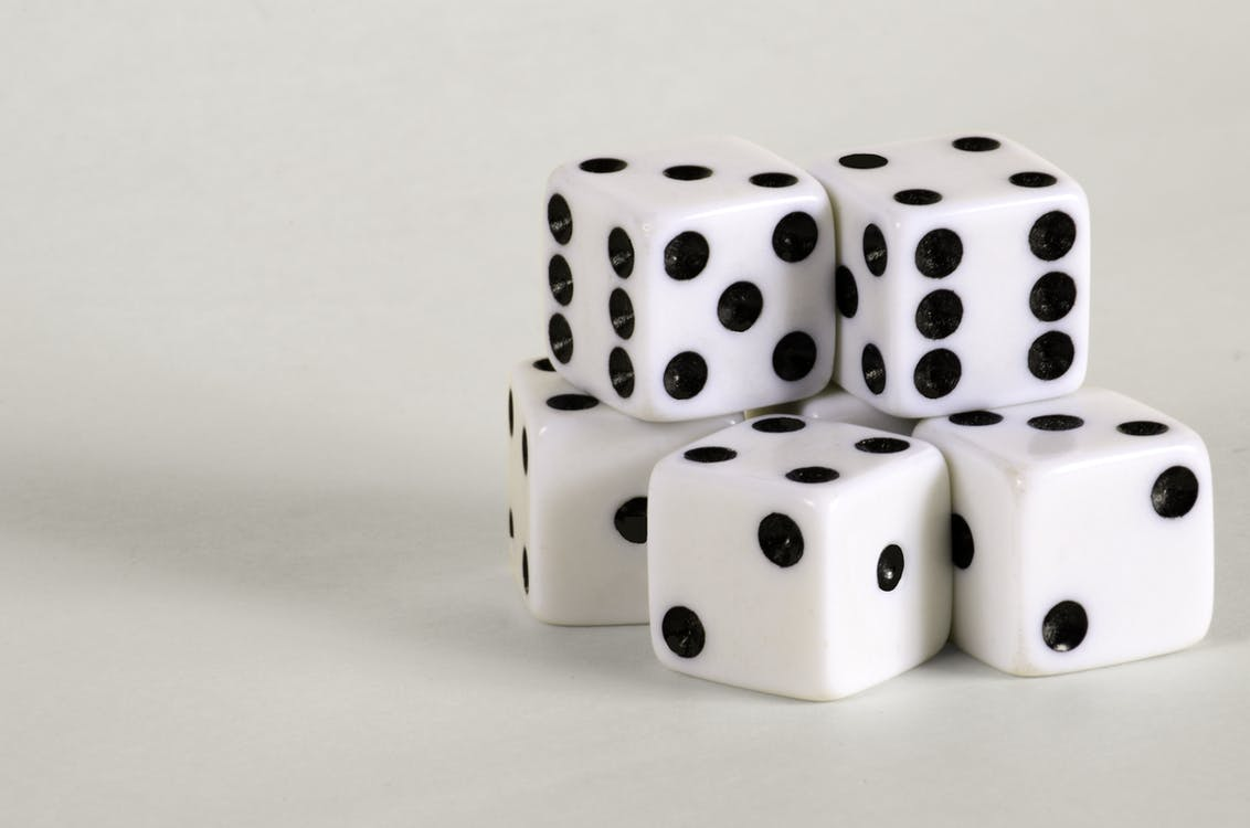 Pile of White Dices on White Surface