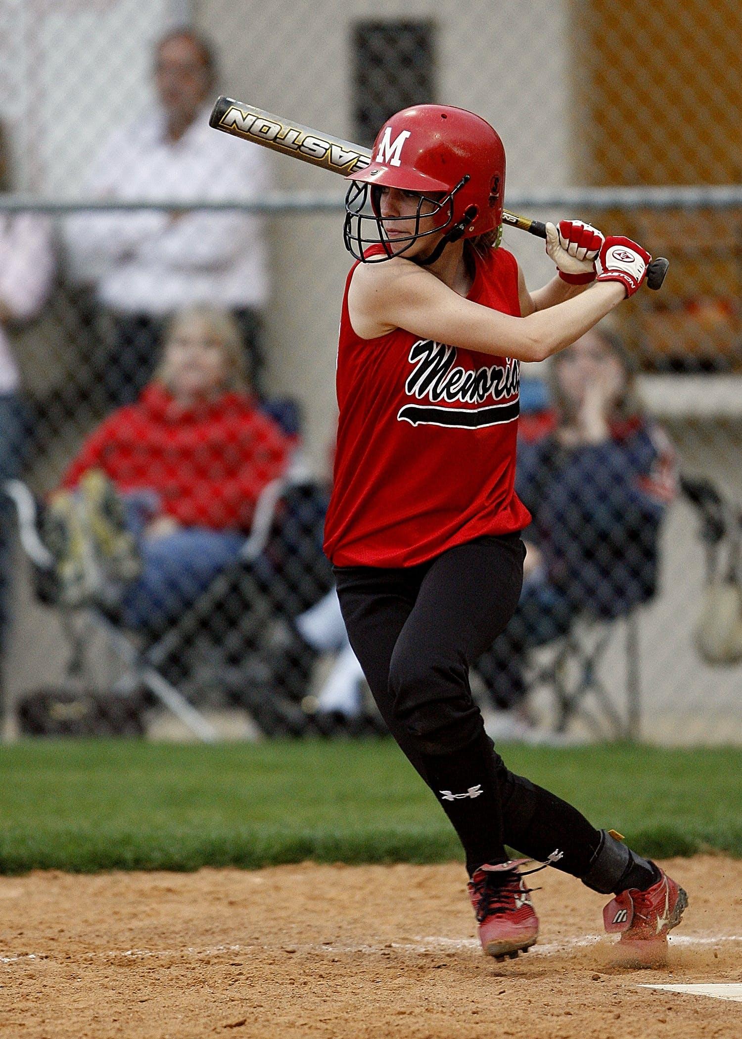 Woman Wearing Baseball Bat in Field